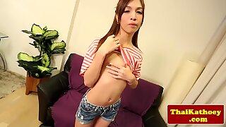 Thai skinny ladyboy with braces jerks herself