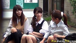 Asian teens pee in park